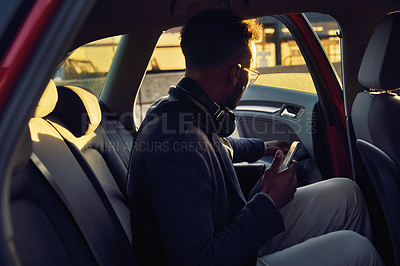Buy stock photo Cropped shot of a handsome young businessman on his morning commute into work