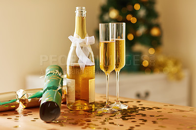 Buy stock photo Shot of champagne and two glasses on a table at Christmas in a home