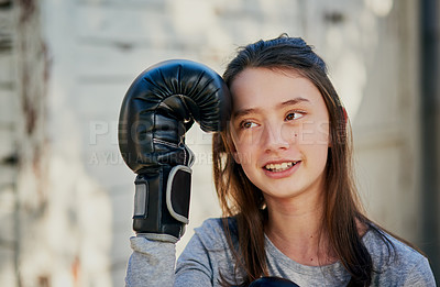 Buy stock photo Shot of a young girl practicing a boxing routine in the garden at home