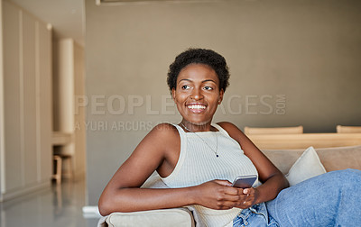 Buy stock photo Shot of a young woman using a smartphone on the sofa at home