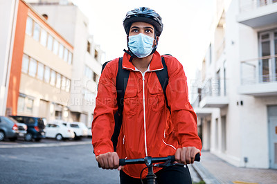 Buy stock photo Shot of a masked man out on his bicycle to do a delivery