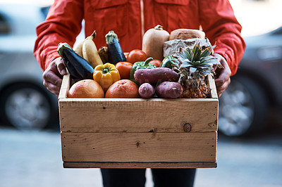Buy stock photo Cropped shot of a man delivering a crate full of fruit and vegetables