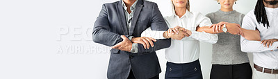 Buy stock photo Closeup shot of a group of unrecognisable businesspeople standing together with their arms linked into each other