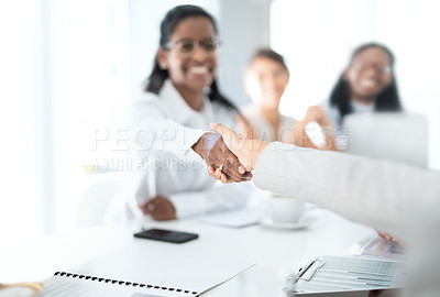 Buy stock photo Closeup shot of two unrecognisable businesspeople shaking hands during a meeting in a boardroom