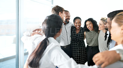 Buy stock photo Shot of a group of businesspeople standing together in a huddle
