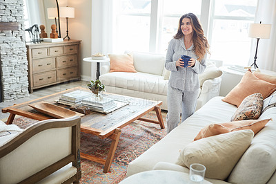 Buy stock photo Shot of a beautiful young woman having coffee during a relaxing morning at home