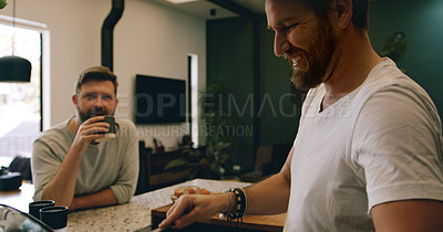 Buy stock photo Shot of a mature couple having coffee and breakfast together at home