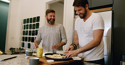 Buy stock photo Shot of a mature couple preparing bagels for breakfast at home