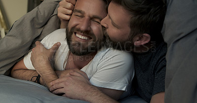 Buy stock photo Cropped shot of an affectionate mature couple sharing a loving moment in their bed at home