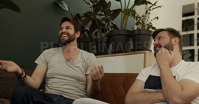 Buy stock photo Shot of a mature couple chatting while watching tv at home