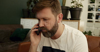 Buy stock photo Shot of a mature man using a smartphone on the sofa at home