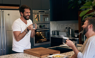 Buy stock photo Shot of a mature couple having coffee, breakfast and a chat at home