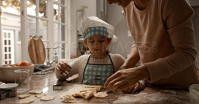 Buy stock photo Cropped shot of a little girl helping her mother to cut out cookies