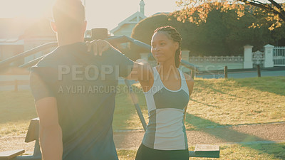 Buy stock photo Shot of a young couple stretching before their workout