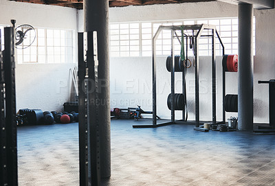 Buy stock photo Cropped shot of a fully-equipped gym with nobody in it