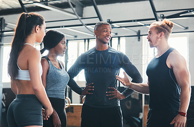 Buy stock photo Cropped shot of a group of young athletes talking while standing in the gym