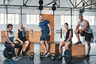 Buy stock photo Full length portrait of a group of young athletes hanging around in the gym after their workout