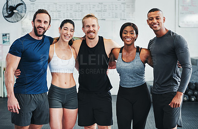 Buy stock photo Cropped portrait of a group of young athletes standing together in the gym