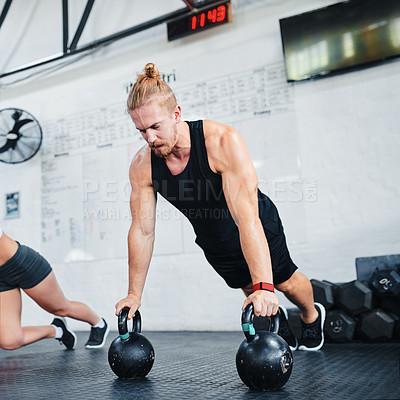 Buy stock photo Shot of an athletic young man working out at the gym