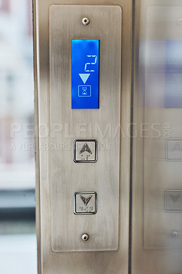 Buy stock photo Shot of a digital display counting the floor levels in an elevator