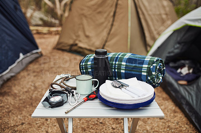 Buy stock photo Shot of cooking utensils on a table at a campsite out in nature