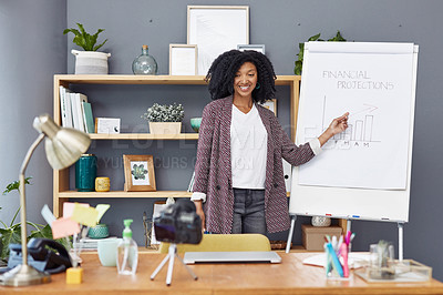 Buy stock photo Shot of a young businesswoman using a camera to record a video of herself speaking