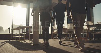 Buy stock photo Closeup shot of a group of unrecognisable businesspeople walking out of a boardroom together