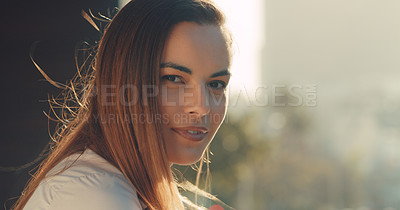 Buy stock photo Cropped portrait of a beautiful young woman standing outside in the city
