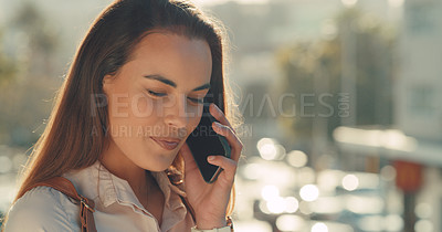 Buy stock photo Cropped shot of a beautiful young woman using her cellphone while standing outside in the city