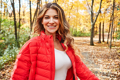 Buy stock photo Cropped portrait of an attractive young woman in the forest during autumn
