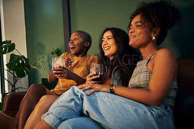 Buy stock photo Shot of three friends having drinks while enjoying a movie night