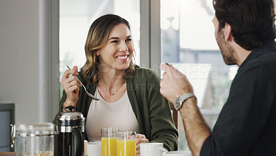 Buy stock photo Shot of a young couple having breakfast together at home