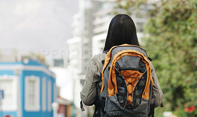 Buy stock photo Rearview shot of a young woman exploring a city