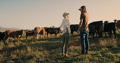 Buy stock photo Shot of a young couple standing together on their farm