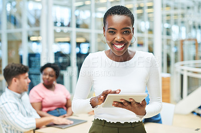 Buy stock photo Shot of a young businesswoman using a digital tablet during a team meeting in a modern office