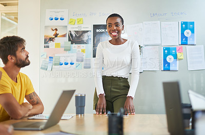 Buy stock photo Shot of a young businesswoman delivering a presentation to colleagues in a modern office