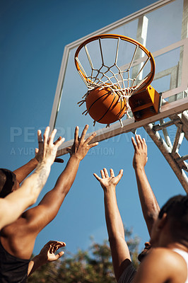 Buy stock photo Closeup shot of a group of sporty young men playing basketball on a sports court