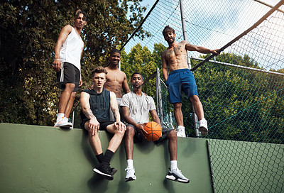 Buy stock photo Portrait of a group of sporty young men hanging out on a basketball court
