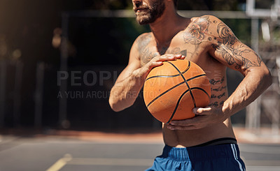 Buy stock photo Closeup shot of a sporty man holding a basketball on a sports court