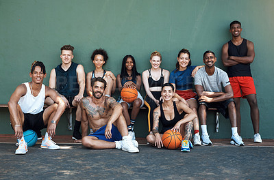 Buy stock photo Portrait of a group of sporty young people taking a break after a game of basketball