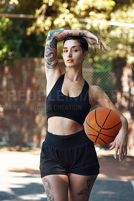 Buy stock photo Cropped portrait of an attractive young female athlete standing on the basketball court