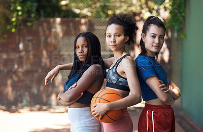 Buy stock photo Cropped portrait of three attractive young female athletes standing together on the basketball court