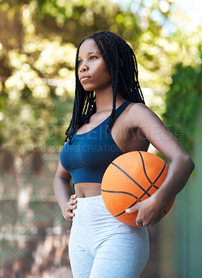 Buy stock photo Cropped shot of an attractive young female athlete standing on the basketball court