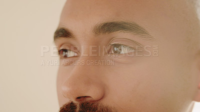 Buy stock photo Shot of a young man looking thoughtful at home