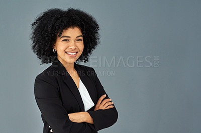 Buy stock photo Shot of a confident young businesswoman standing against a grey studio background