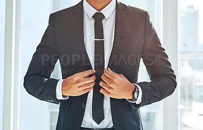Buy stock photo Cropped shot of a businessman wearing a stylish suit in a modern office