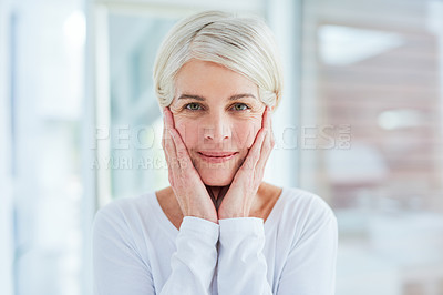 Buy stock photo Portrait of a mature woman touching her face in a bathroom at home