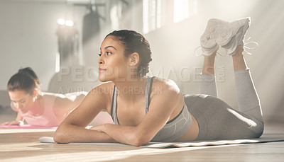 Buy stock photo Shot of two young female athletes taking a break while at the gym