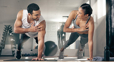 Buy stock photo Shot of two young athletes working out together at the gym