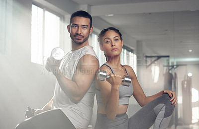 Buy stock photo Cropped shot of two young athletes holding dumbbells